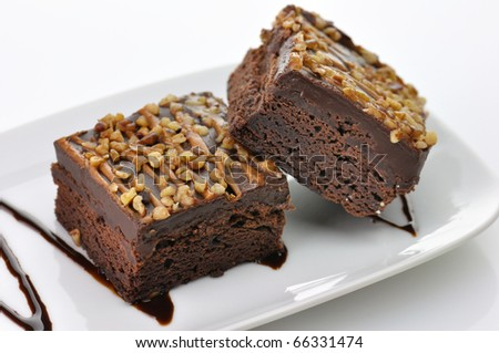 brownies with chocolate sauce - stock photo