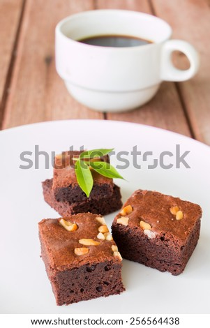 brownies with cup of coffee on table