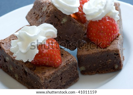 Brownies with strawberries and cream - stock photo