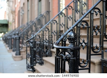 Brownstone Apartment steps in the Chelsea neighborhood of New York City. - stock photo