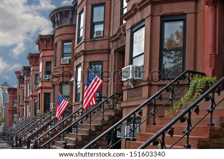 Brownstone Brooklyn/view of brownstone row houses in Sunset Park neighborhood of Brooklyn, New York. - stock photo