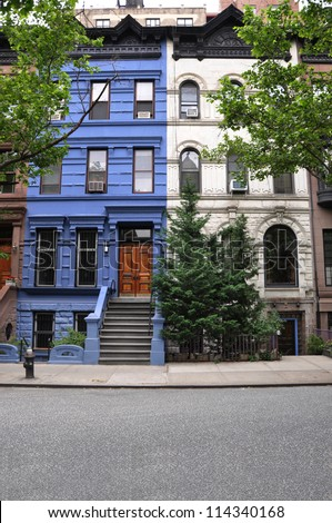 Brownstone Home Painted Blue Limestone Residence Painted White in urban USA neighborhood Manhattan - stock photo