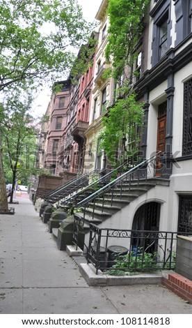 Brownstone Homes along cement sidewalk in Brooklyn New York - stock photo