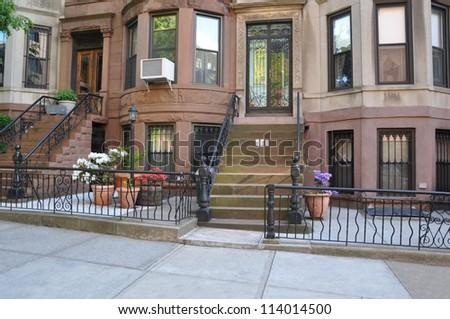 Brownstone Homes Entrance Steps Potted Azaleas Flowers Rod Iron Gate - stock photo