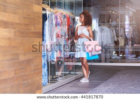 Browsing shops at the mall - stock photo