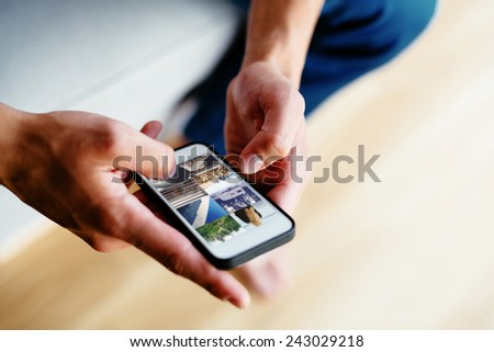 Browsing social media on smartphone. Close-up - stock photo