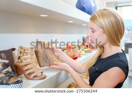 Browsing the shoe collection - stock photo