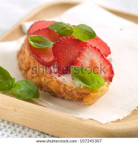 Brschetta with cheese, strawberry and basil, selective focus