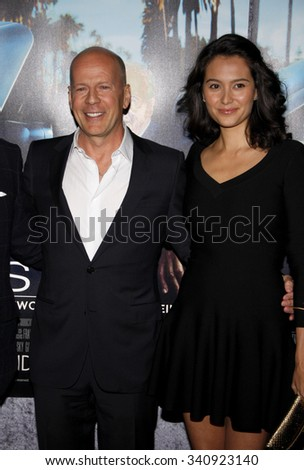 """Bruce Willis and actress Emma Heming at the Los Angeles Premiere of """"His Way"""" held at the Paramount Pictures Studios in Los Angeles, California, United States on March 22, 2011. - stock photo"""