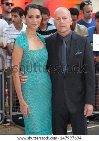 Bruce Willis and wife Emma arriving for the UK Premiere of Red 2, at Empire Leicester Square, London. 22/07/2013 - stock photo
