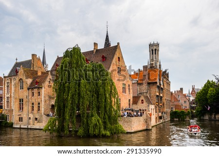 BRUGE, BELGIUM - JUN 5, 2015: Rozenhoedkaai, Historic Centre of Bruges, Belgium. part of the UNESCO World Heritage site