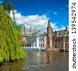 """BRUGES, BELGIUM - APRIL 20: Houses along the canals of Brugge or Bruges, Belgium on April 20, 2012. Bruges is frequently referred to as """"The Venice of the North"""" for its canals. - stock photo"""
