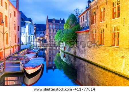 Bruges, Belgium. Beautiful night view of city canal and medieval architecture. - stock photo