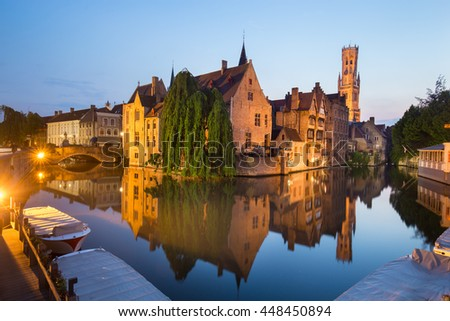 Bruges, Belgium. Image with Rozenhoedkaai in Brugge, Dijver river canal and Belfort, Belfry, tower in twilight.