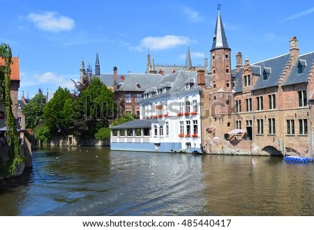 BRUGES, BELGIUM - JULY 25 2016 Picture of the canal in the streets of Bruges, a medieval city in Belgium, witth a look on the ancient buildings,a  view on July 15 2016.