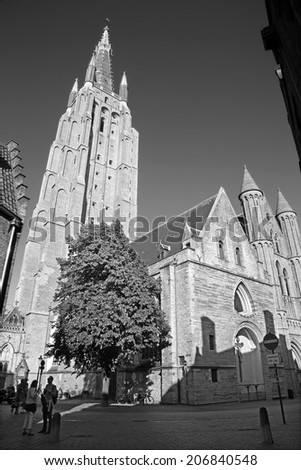 BRUGES, BELGIUM - JUNE 13, 2014: Church of Our Lady from south - west in evening light