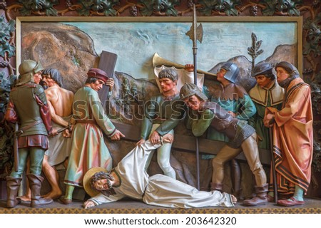 BRUGES, BELGIUM - JUNE 13, 2014: Jesus falls under the cross. Relief in st. Giles church (Sint Gilliskerk) as part of the Passion of Christ cycle.