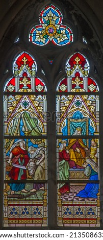 BRUGES, BELGIUM - JUNE 12, 2014: Scenes the king Salomon and Queen of Saba and Judith with the Head of Holophernes  on windwopane in st. Jacobs church (Jakobskerk) by J. Dobbelare (1901).