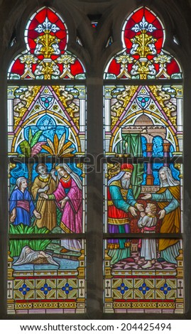 BRUGES, BELGIUM - JUNE 12, 2014: Scenes The Presentation of Jesus in the Temple and The Moses rescued from the Nile st. Joseph on windwopane in st. Jacobs church (Jakobskerk) by J. Dobbelare (1901).  - stock photo