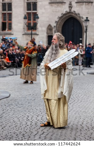 BRUGES, BELGIUM - MAY 17: Annual Procession of Holy Blood on Ascension Day. Locals perform  dramatizations of Biblical events - Moses with Ten Commandments. May 17, 2012 in Bruges (Brugge), Belgium - stock photo