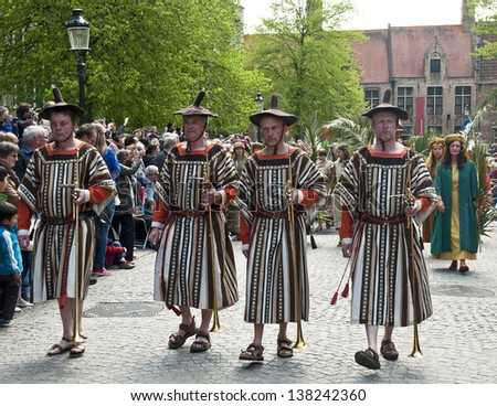 BRUGES, BELGIUM - MAY 9: Annual Procession of the Holy Blood on Ascension Day. Locals perform a historical reenactment and dramatizations of Biblical events in the city. May 9, 2013 in Bruges, Belgium