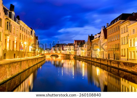 Bruges, Belgium. Night shot of historic medieval buildings along water canal in Brugge, Belgium - stock photo