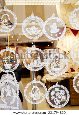 BRUGES, BELGIUM - OCTOBER 18: Christmas lace decoration in the shop window in Bruges, Belgium in October 18, 2014  - stock photo