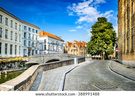 """Bruges, Belgium. Scenery with water canal in Brugge, """"Venice of the North"""", cityscape of Flanders, Belgium - stock photo"""