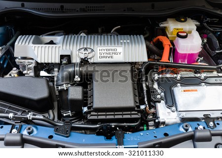BRUGES, BELGIUM - SEPTEMBER 25, 2015: Toyota Hybrid Synergy Drive car engine in Prius and Camry. The system combines a battery powered electric motor and a petrol driven combustion engine - stock photo