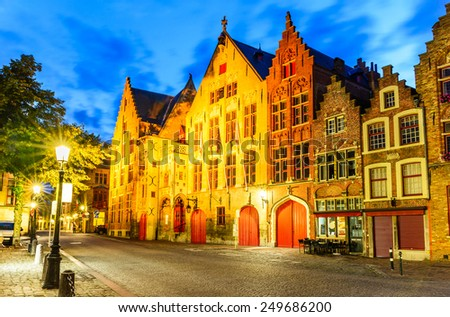 Bruges, Belgium. Twilight image with Hanseatic medieval square of Brugge, old Flanders gothic city in Belgium. - stock photo
