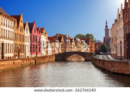 Bruges canals: Spiegelrei and Jan van Eyckplein as background. Belgium - stock photo