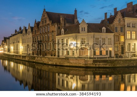 Bruges City, Scenic Old town view canal Spiegelrei with beautiful medieval houses cityscape and reflections at night, Belgium