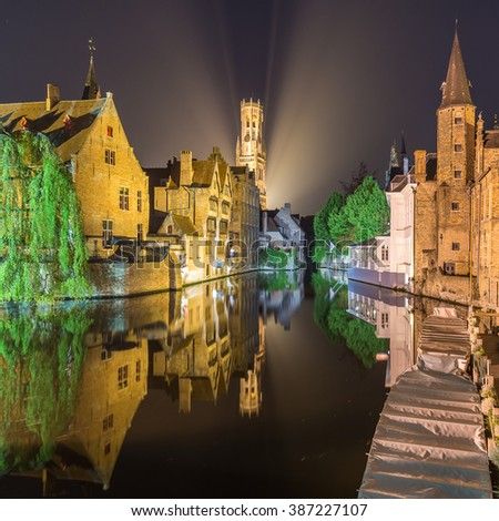Bruges City, The dock of the Rosary (Rozenhoedkaai) Reflection of Illuminated Old Building Cityscape at night, Belgium