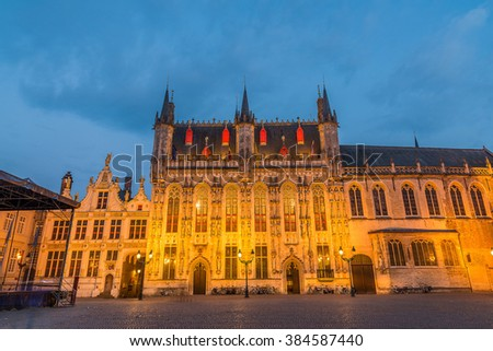 Bruges, Famous Scenic skyline with the picturesque night medieval City Hall of Bruges (Stadhuis van Brugge) at Burg Square Illuminated cityscape under dramatic sky in Summer, Belgium - stock photo