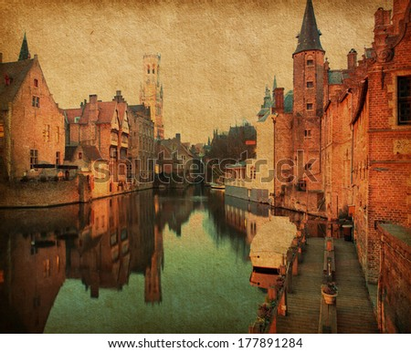 Bruges historic centreat the evening . The classic view from the Rozenhoedkaai. Belgium. Photo in retro style. Added paper texture. - stock photo