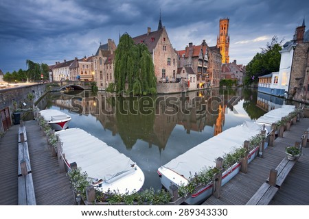 Bruges. Image of famous most photographed location in Bruges, Belgium during twilight blue hour. - stock photo