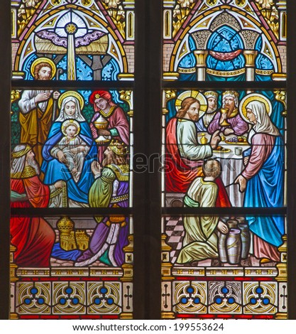 BRUGGE, BELGIUM - JUNE 12, 2014: The Adoration of Magi and the Wedding at Cana scene on the windwopane in st. Jacobs church (Jakobskerk).