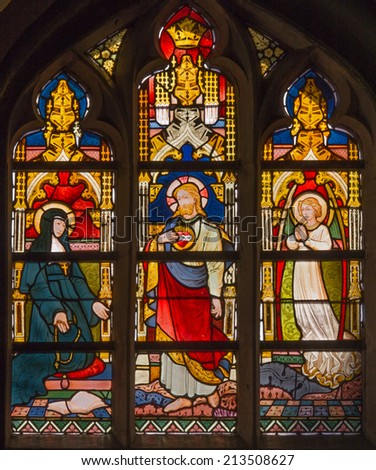 BRUGGE, BELGIUM - JUNE 13, 2014: The Windowpane with the scene of Jesus appearing to Saint Margaret Mary Alacoque from 19. cent. in the in st. Giles (Sint Gilliskerk).