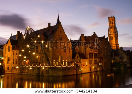 Brugge Belgium ?? November 25, 2015 : Long exposure of the city of Brugge in the dark night with dramatic sky and tower in the background during winter time