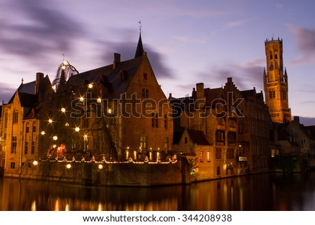 Brugge Belgium â?? November 25, 2015 : Long exposure of the city of Brugge in the night time with beautiful sky and tower in the background during winter time