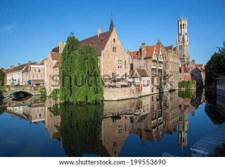Brugge - View from the Rozenhoedkaai in Brugge with the Perez de Malvenda house and Belfort van Brugge in the background in morning light. - stock photo