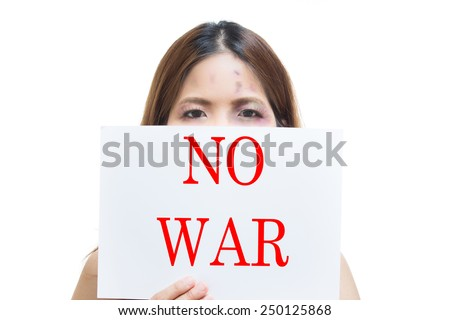 bruised face woman holding NO WAR label - stock photo