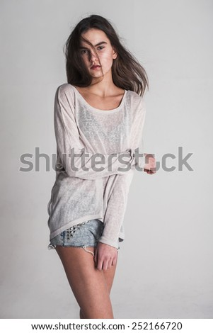 Brunet cheerful young woman. Beauty portrait, perfect makeup. Long chic elegant hair. Model tests. Girl in white. - stock photo