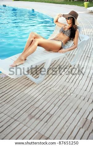 Brunette beauty on vacation day - stock photo