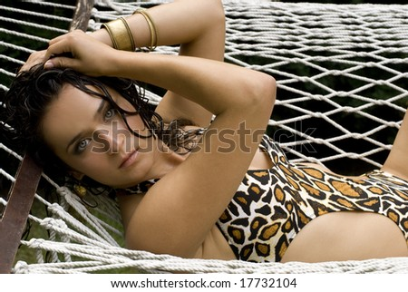 Brunette beauty posing sexy for camera on a sunny day - stock photo