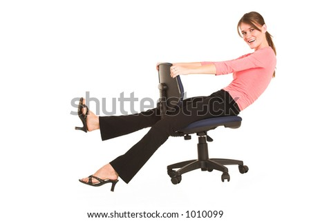 brunette business lady in pink top.  Playing around on office chair - copy space