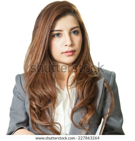 Brunette businesswoman holding note book and a pen, attractive young pretty in office standing enjoy using a pen writing diary note book ponder positive on white background - stock photo