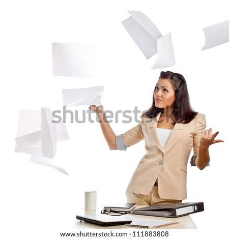 brunette businesswoman throwing up papers in the air - stock photo