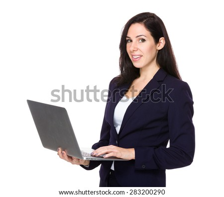 Brunette businesswoman use of laptop computer - stock photo