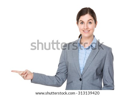 Brunette businesswoman with finger point aside